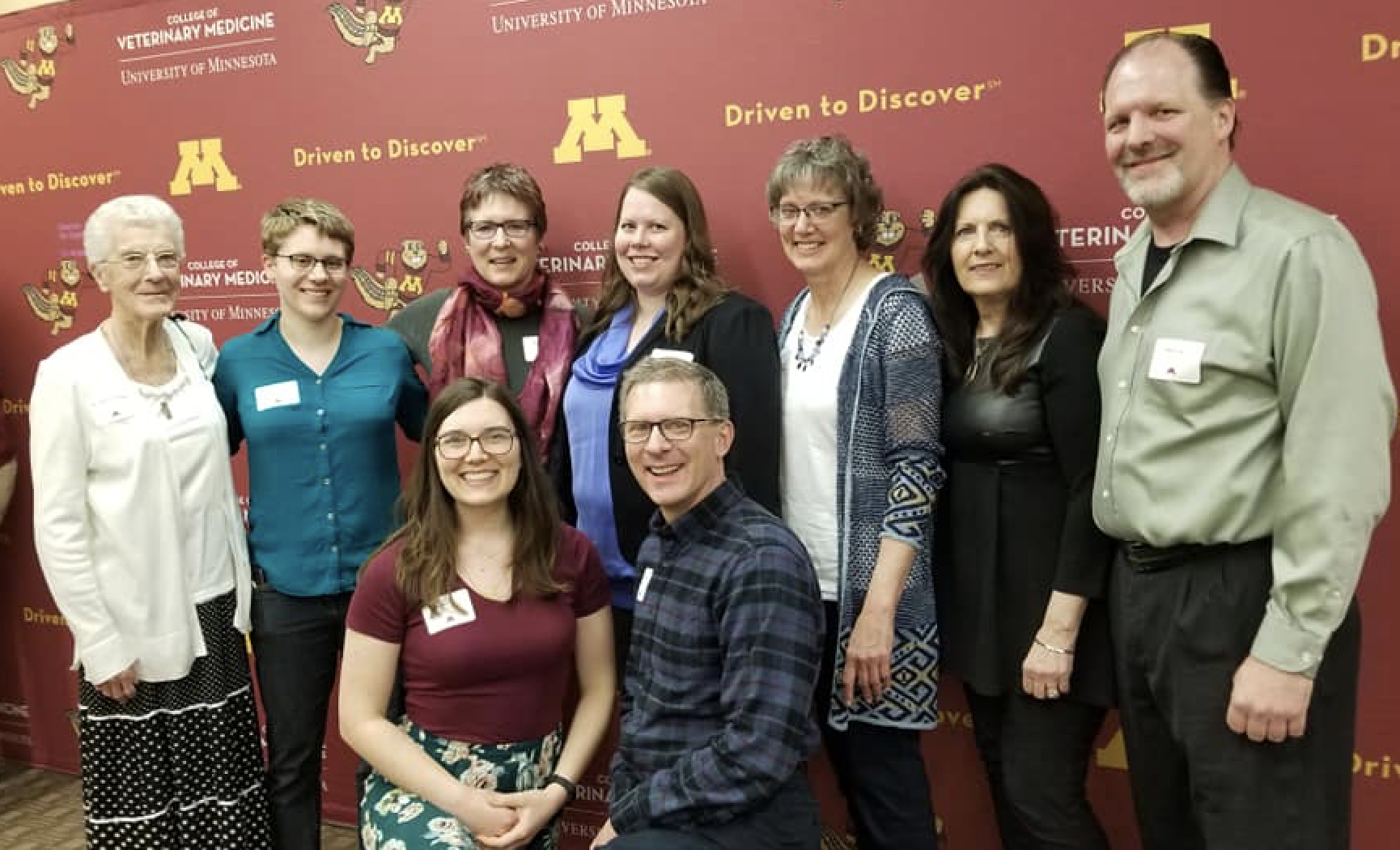 Janet Veit's family, friends, and colleagues post with Janna Erickson for a photo at 2019 Scholarship Reception