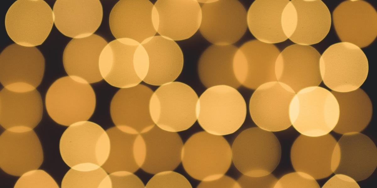 An abstract image of lights, zoomed in so they look like overlapping dots.