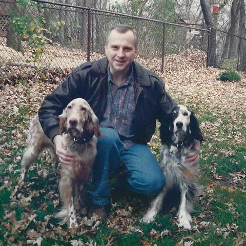 Tim Nornes with the Nornes' two setters, Chelsea and Annie